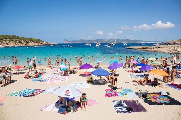 People Enjoy the Beach in Ibiza