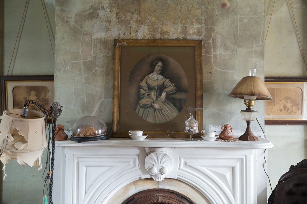 portrait of a woman above a mantle