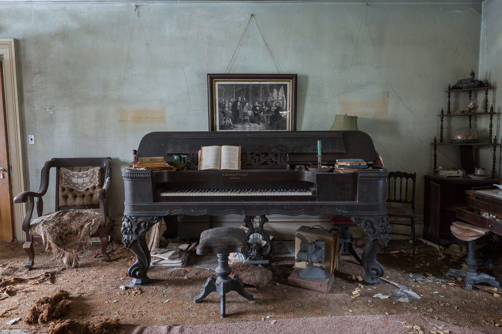 an old piano in the parlor