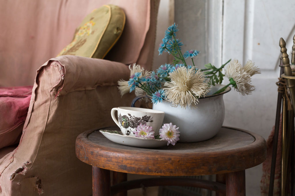 teacup and floral arrangement on table