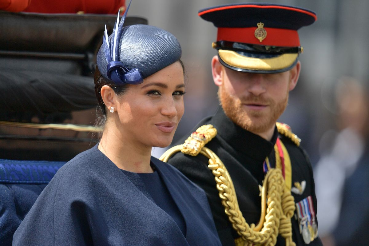 Britain's Meghan, Duchess of Sussex (L) and Britain's Prince Harry, Duke of Sussex (R) return to Buckingham Palace after the Queen's Birthday Parade, 'Trooping the Colour', in London on June 8, 2019.