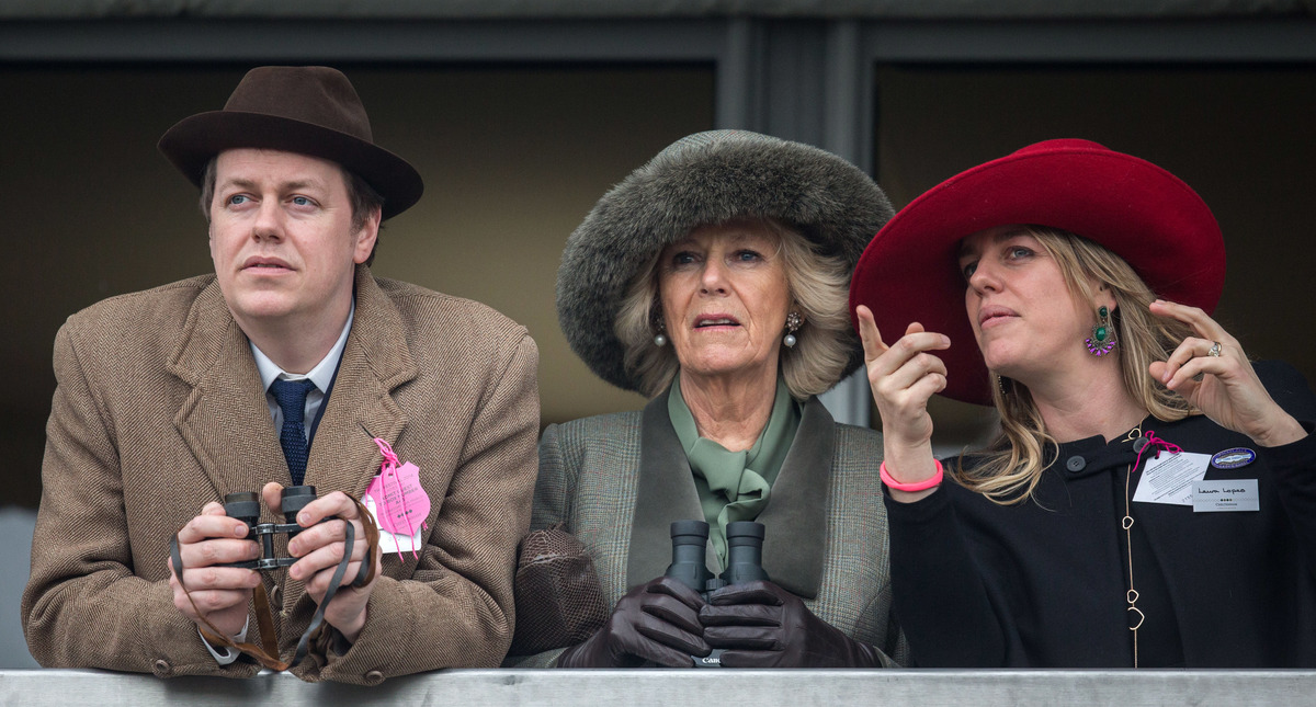 Camilla, Duchess of Cornwall (C) watches a race from the temporary Royal Box with her son Tom Parker Bowles and daughter Laura Lopes on the second day of the Cheltenham Festival on March 11, 2015 in Cheltenham, England.
