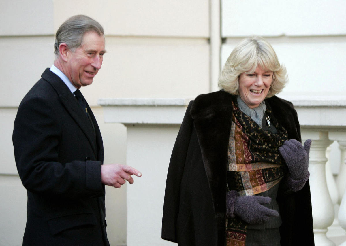 Britain's Prince Charles stands with his fiancee Camilla Parker Bowles during an engagement at Clarence House in London where they met with British explorers 21 February 2005.