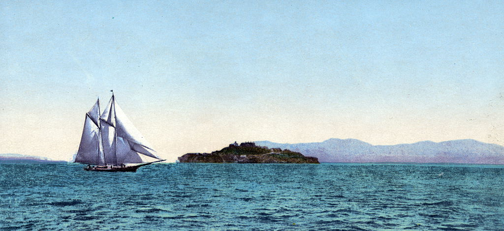 a colorized photo of alcatraz island from the 1800s