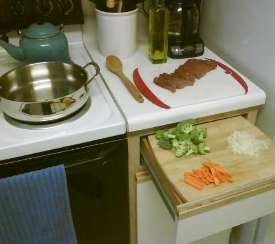 a drawer open with a cutting board on top