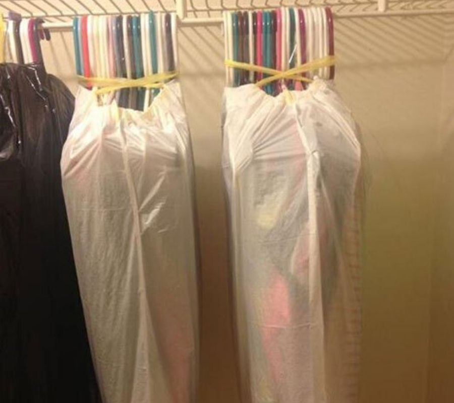 groups of hangers covered and held together by garbage bags