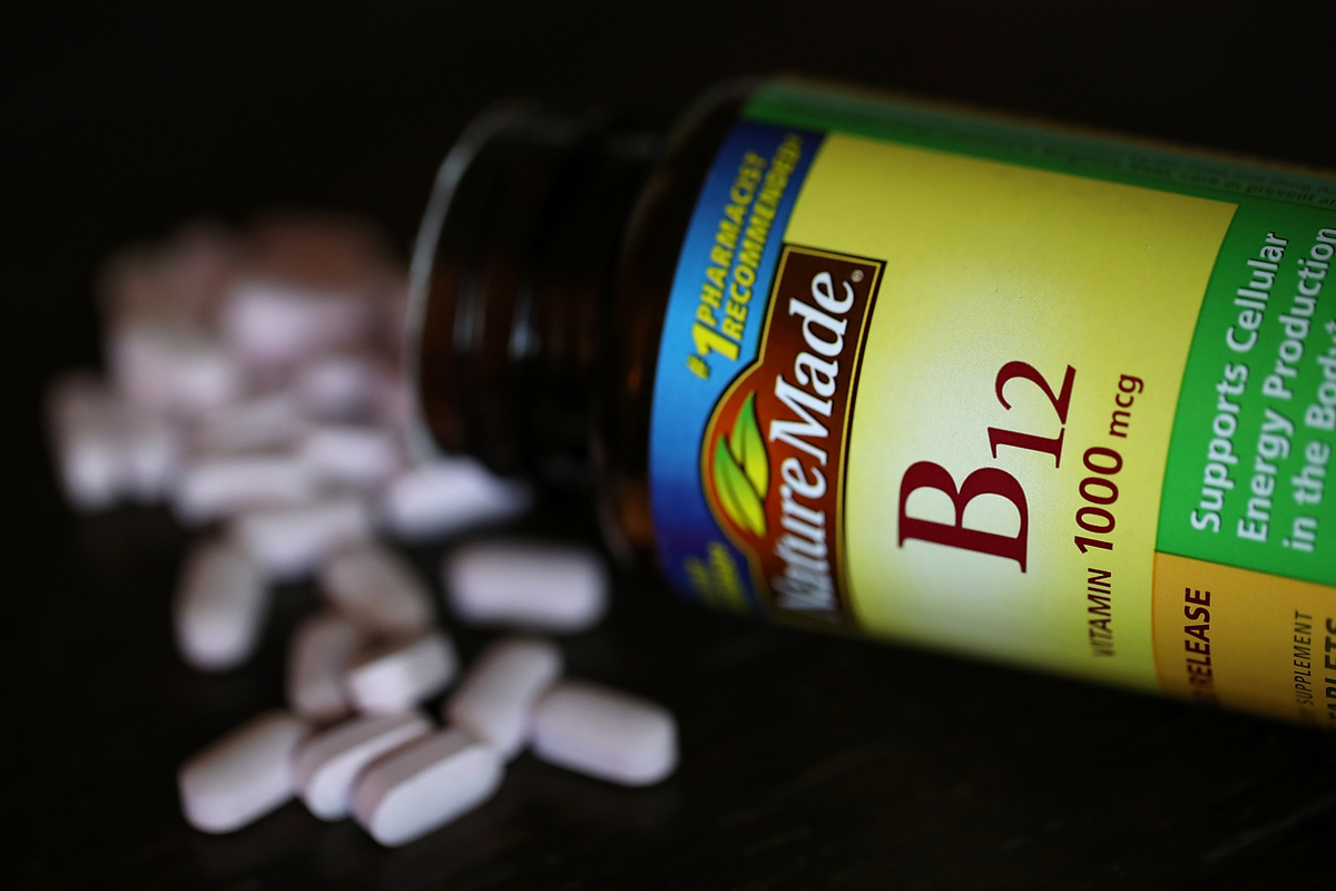 A spilled bottle of vitamins B12 pills is displayed.
