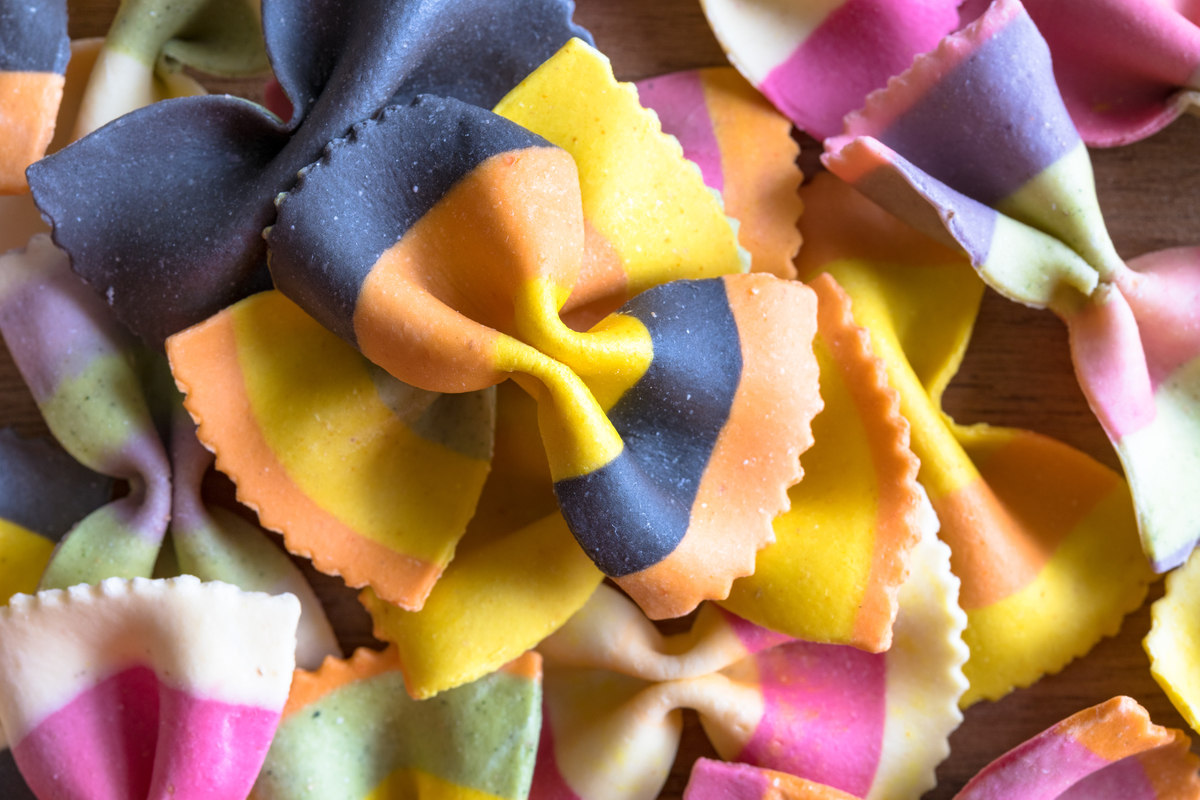Pasta with vibrant, artificial colors is piled.