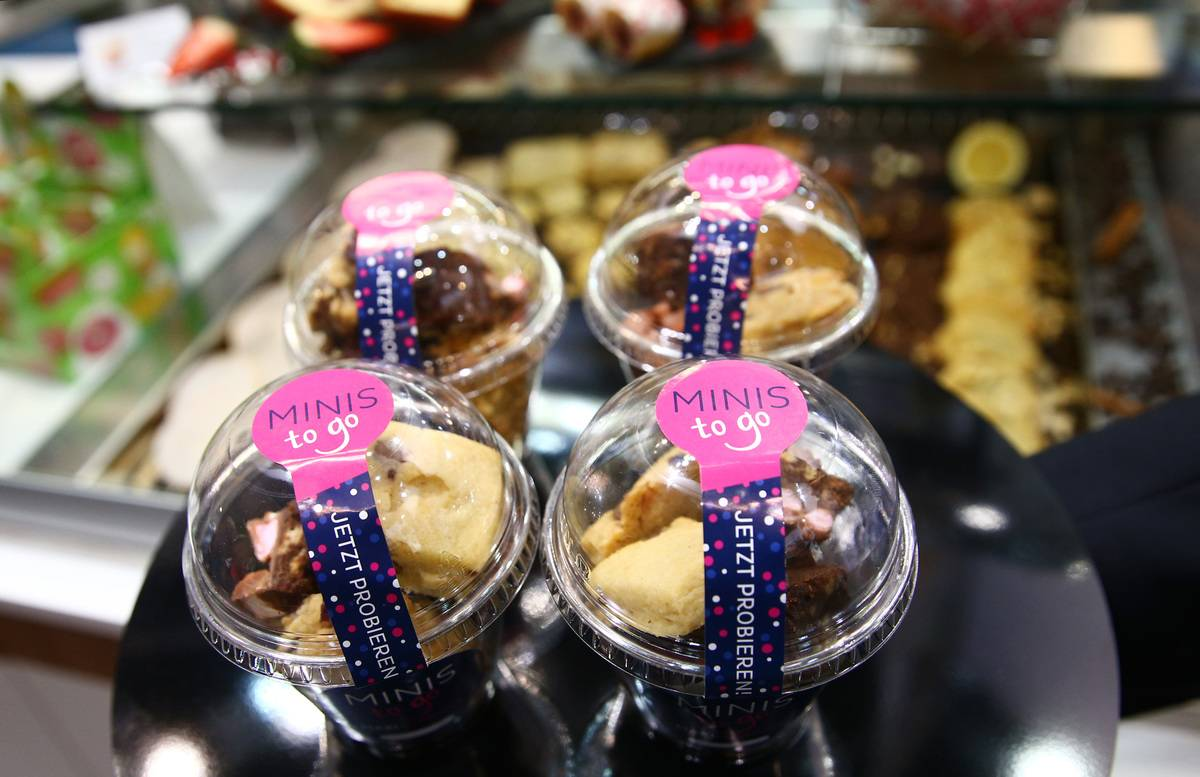 Miniature pastries are packaged and sold to-go.