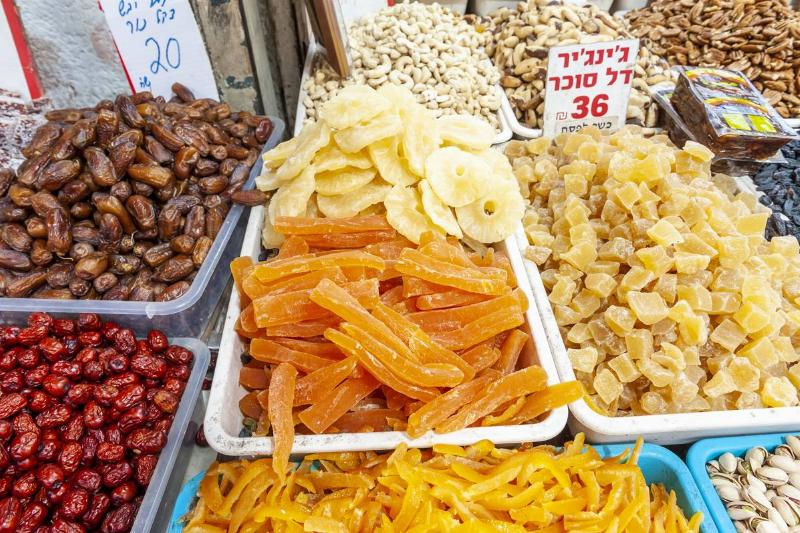 Dried fruit is displayed and sold at a market in Israel.