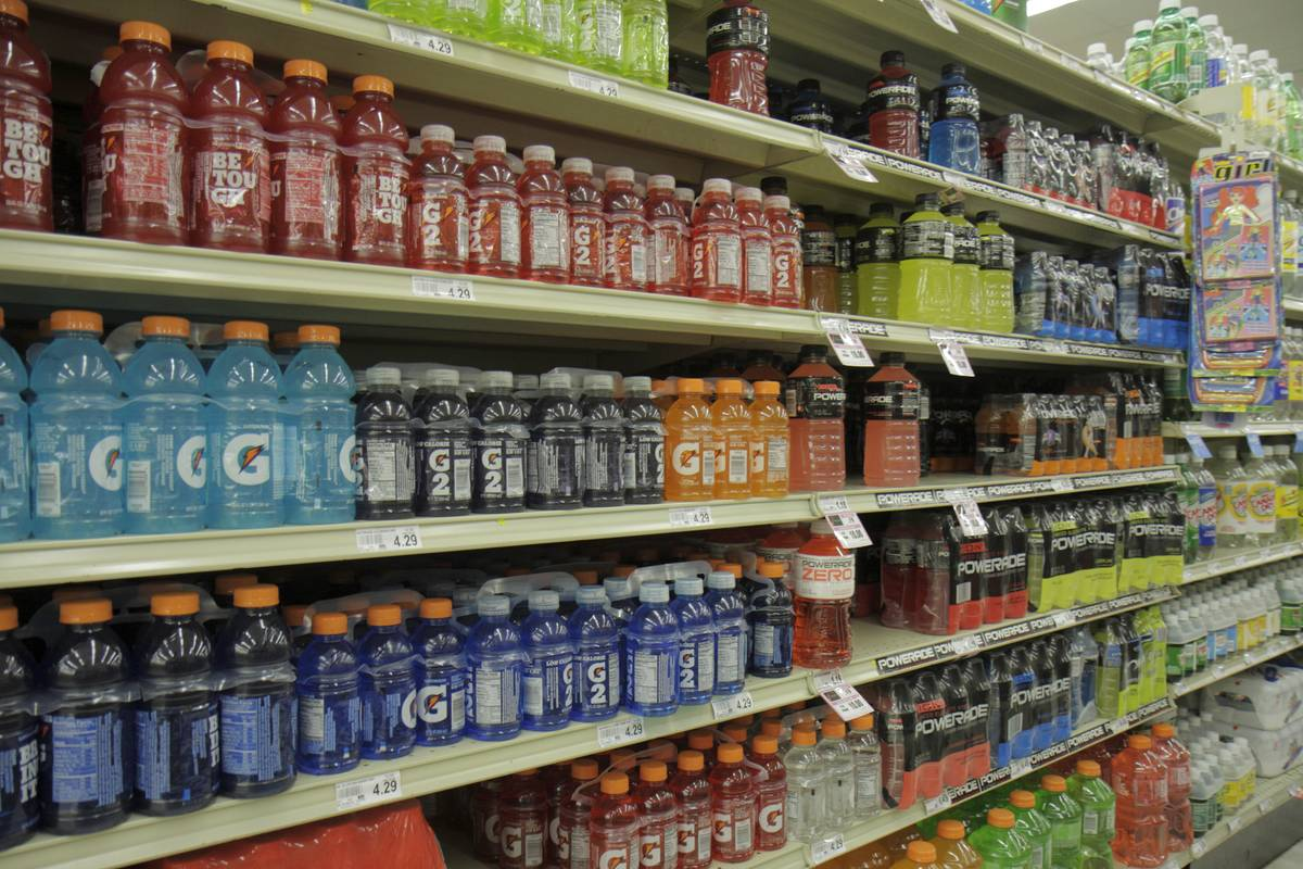Shelves of sports drinks are for sale at a supermarket.