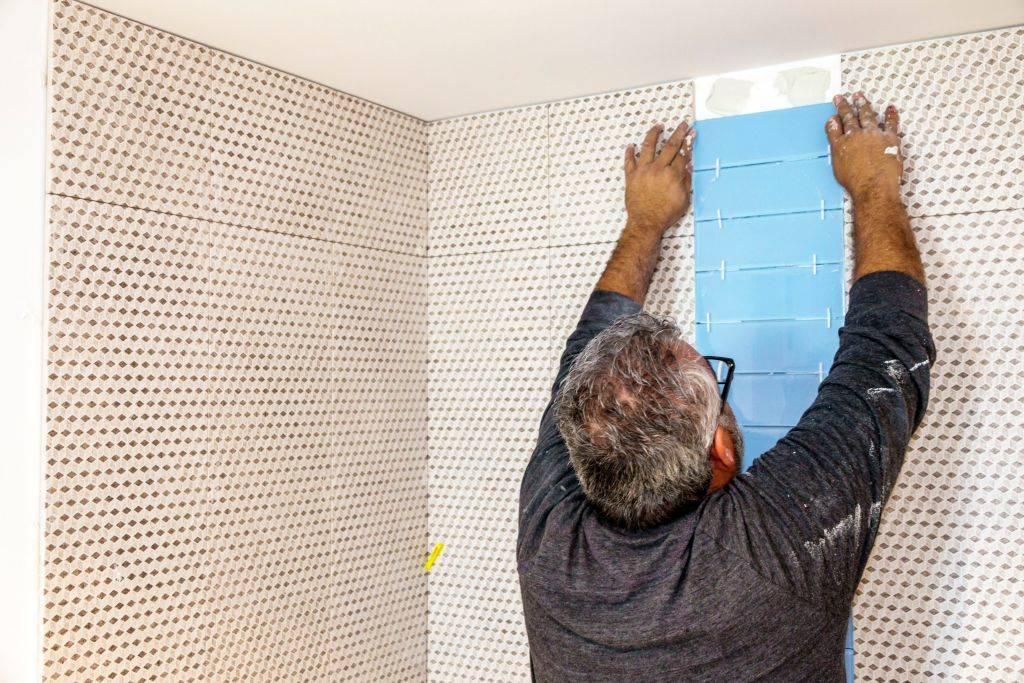 Miami Beach, contractor installing bathroom tile.