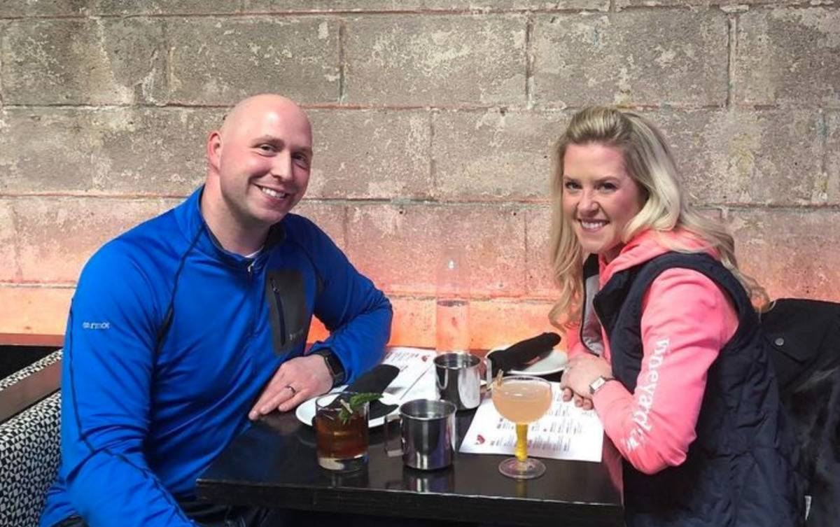 Kathy and Brandon Gunn sit at dinner.