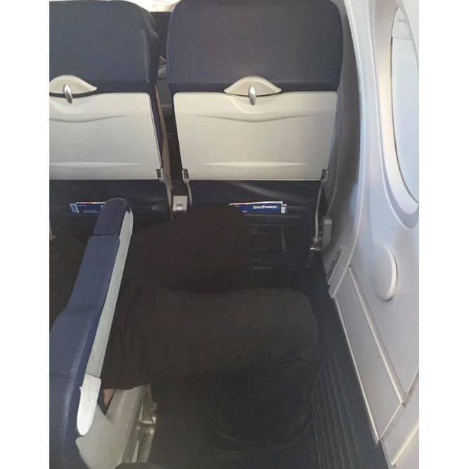 person sitting sideways on a plane