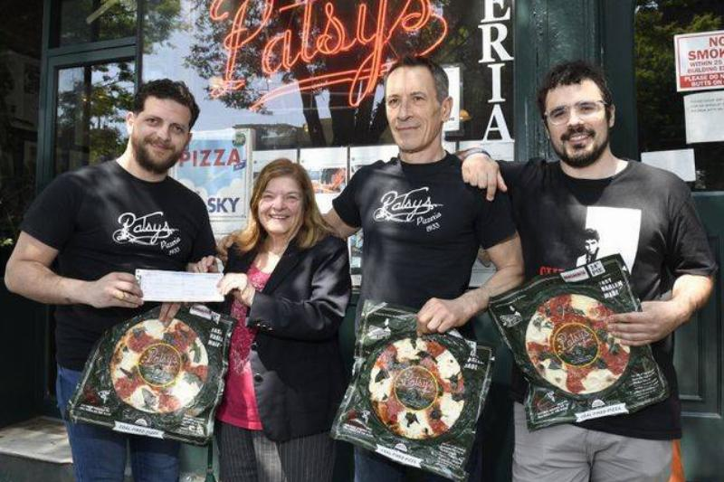 Staff at Patsy's pose for a photo with Vinacour and her lost check.