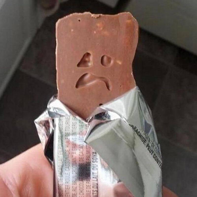 sad face on chocolate bar