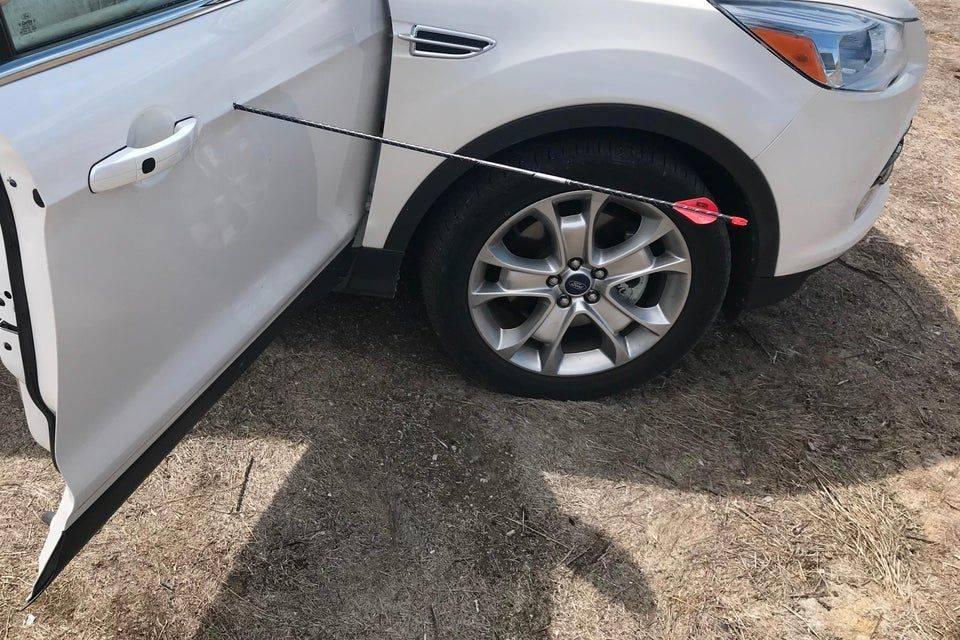 arrow in side of car