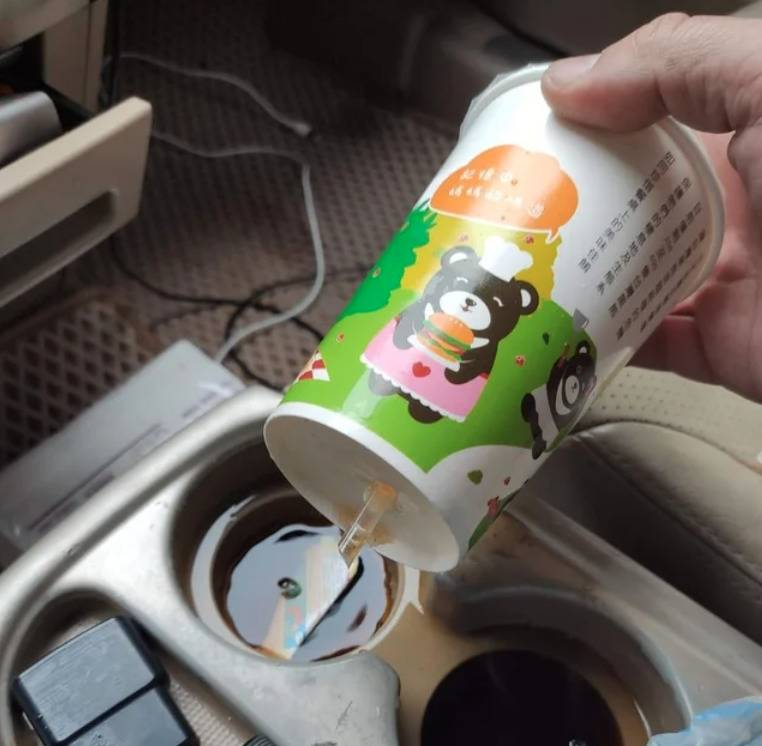 straw in takeaway cup pierced the bottom of it so it leaked into car cupholder