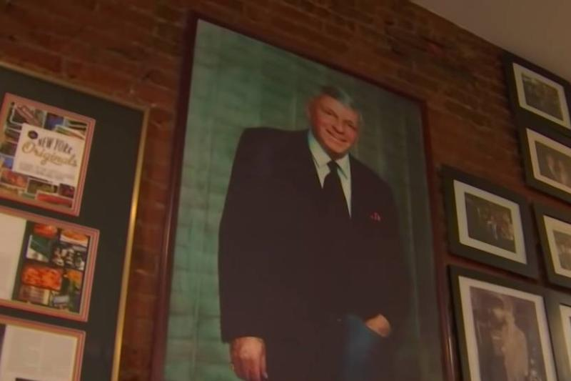 Patsy's Pizzeria includes portraits of famous figures and past customers on the wall.