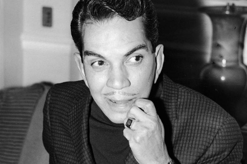 Mexican comedian Cantinflas looks thoughtful as he sits in his London hotel room before meeting actors for casting in his new film 'Pepe,' London, England, April 26, 1959