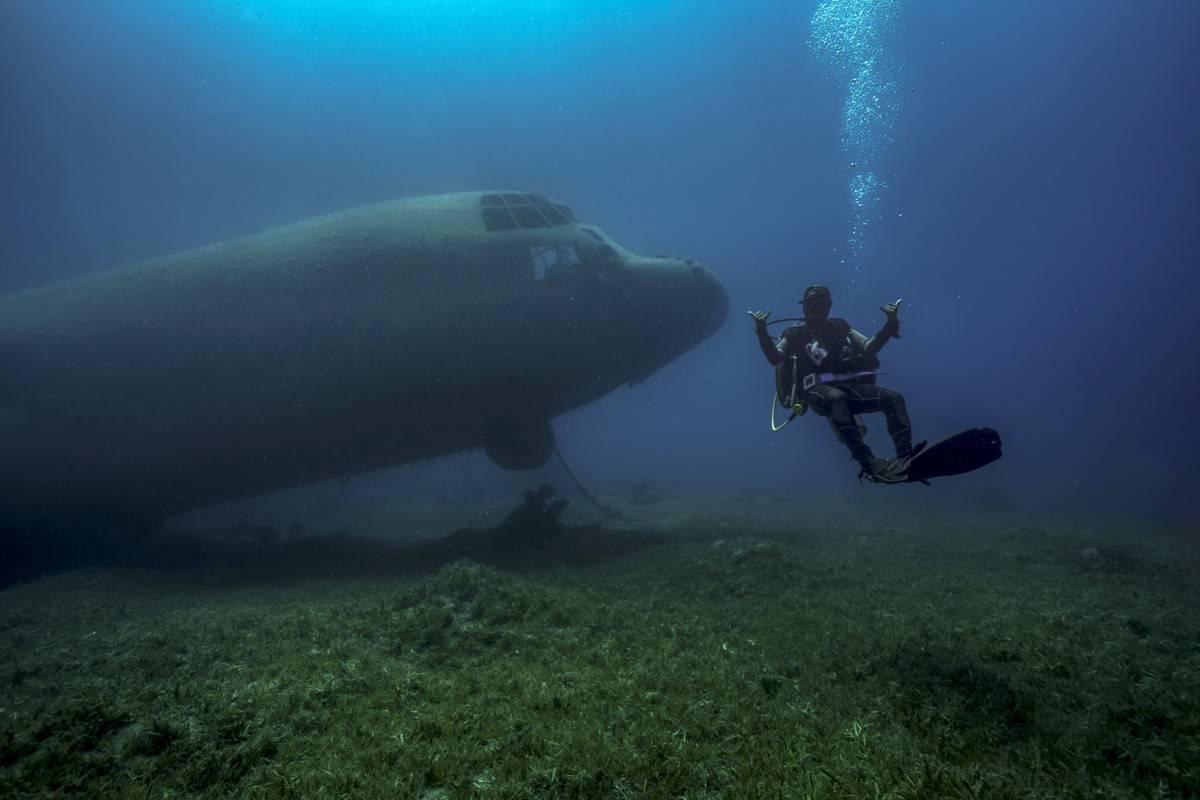 A diver swims next to the underwater C130 cargo plane near Aqaba, Jordan.