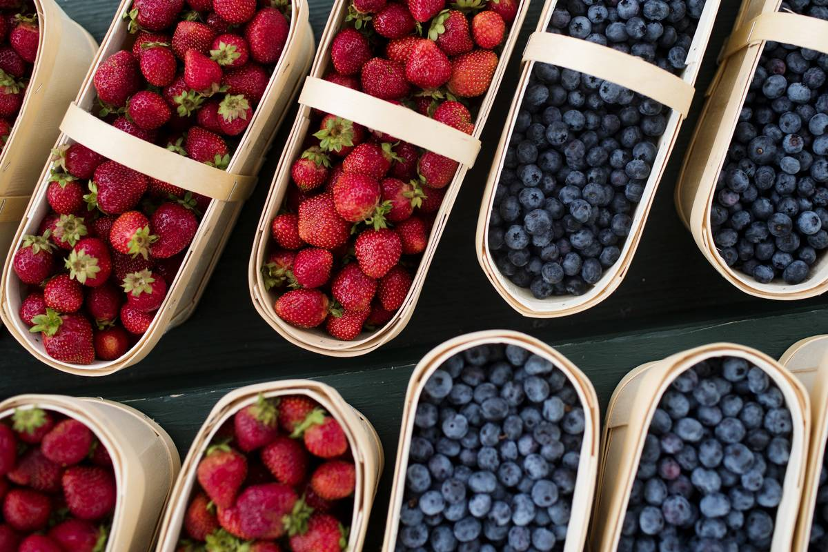 Baskets of strawberries and blueberries sit on display for sale at a stall in ByWard Market in Ottawa, Ontario, Canada, on Thursday, Aug. 16, 2018