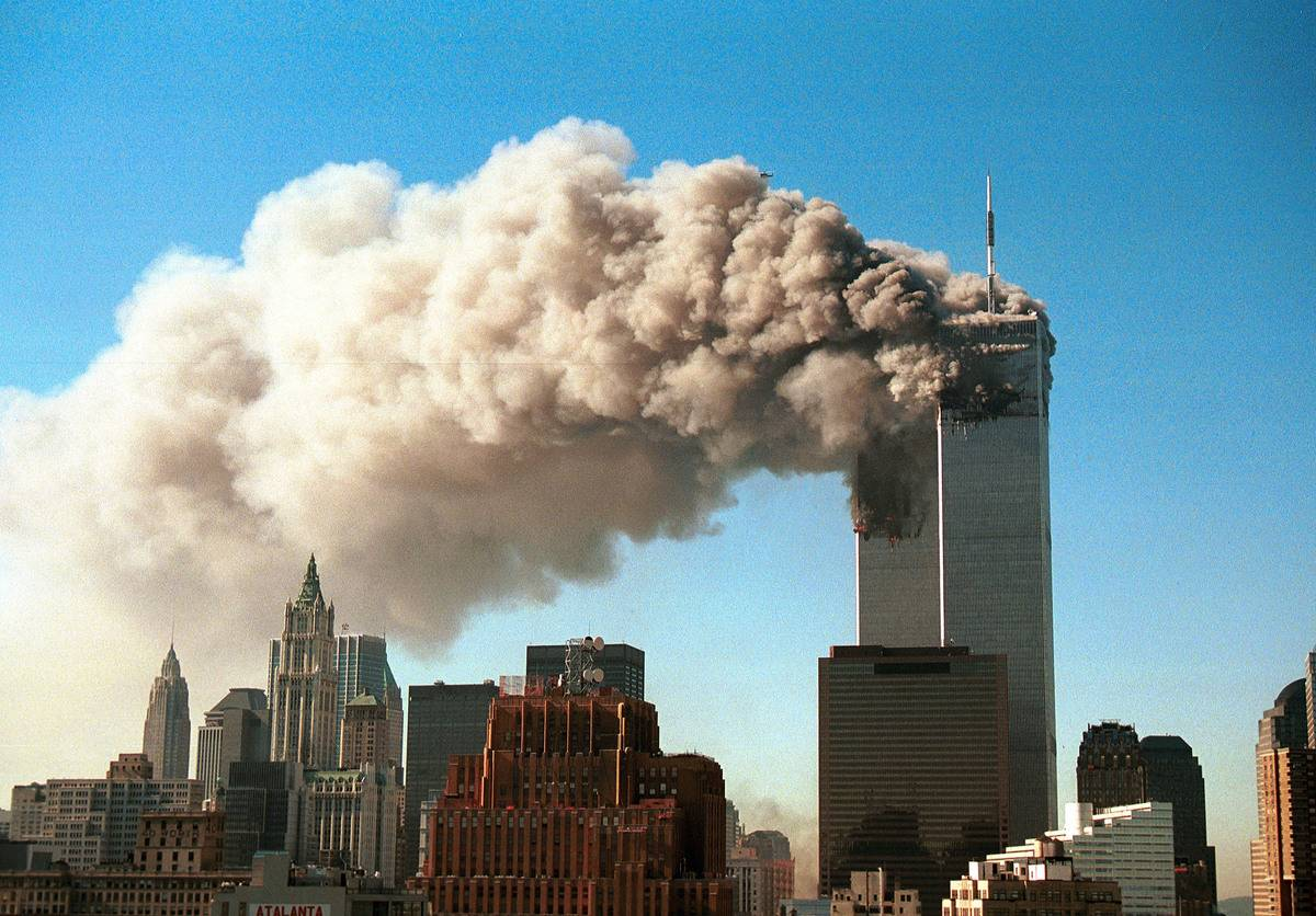 Smoke pours from the twin towers of the World Trade Center after they were hit by two hijacked airliners in a terrorist attack September 11, 2001 in New York City