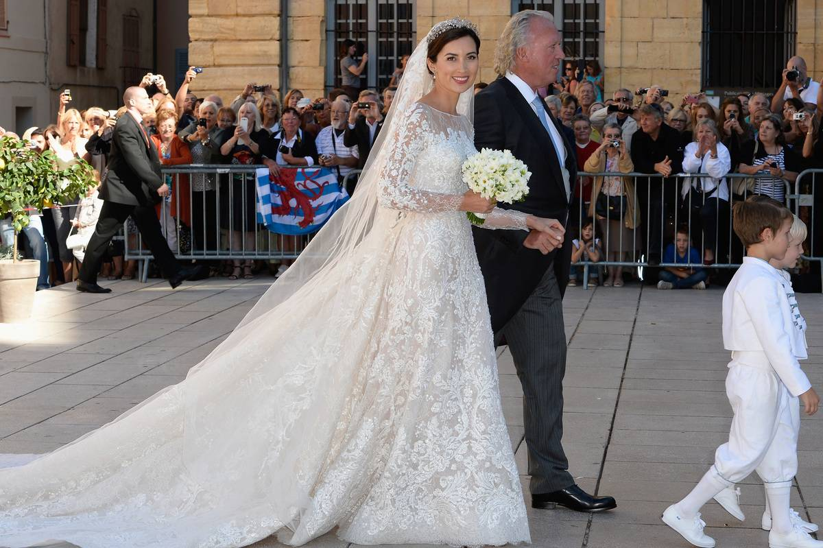 Princess Claire Of Luxembourg, her father Hartmut Lademacher, Prince Gabriel Of Luxembourg and Prince Noah Of Luxembourg arrive to the Religious Wedding Of Prince Felix Of Luxembourg and Claire Lademacher at the Basilique Sainte Marie-Madeleine on September 21, 2013 in Saint-Maximin-La-Sainte-Baume, France