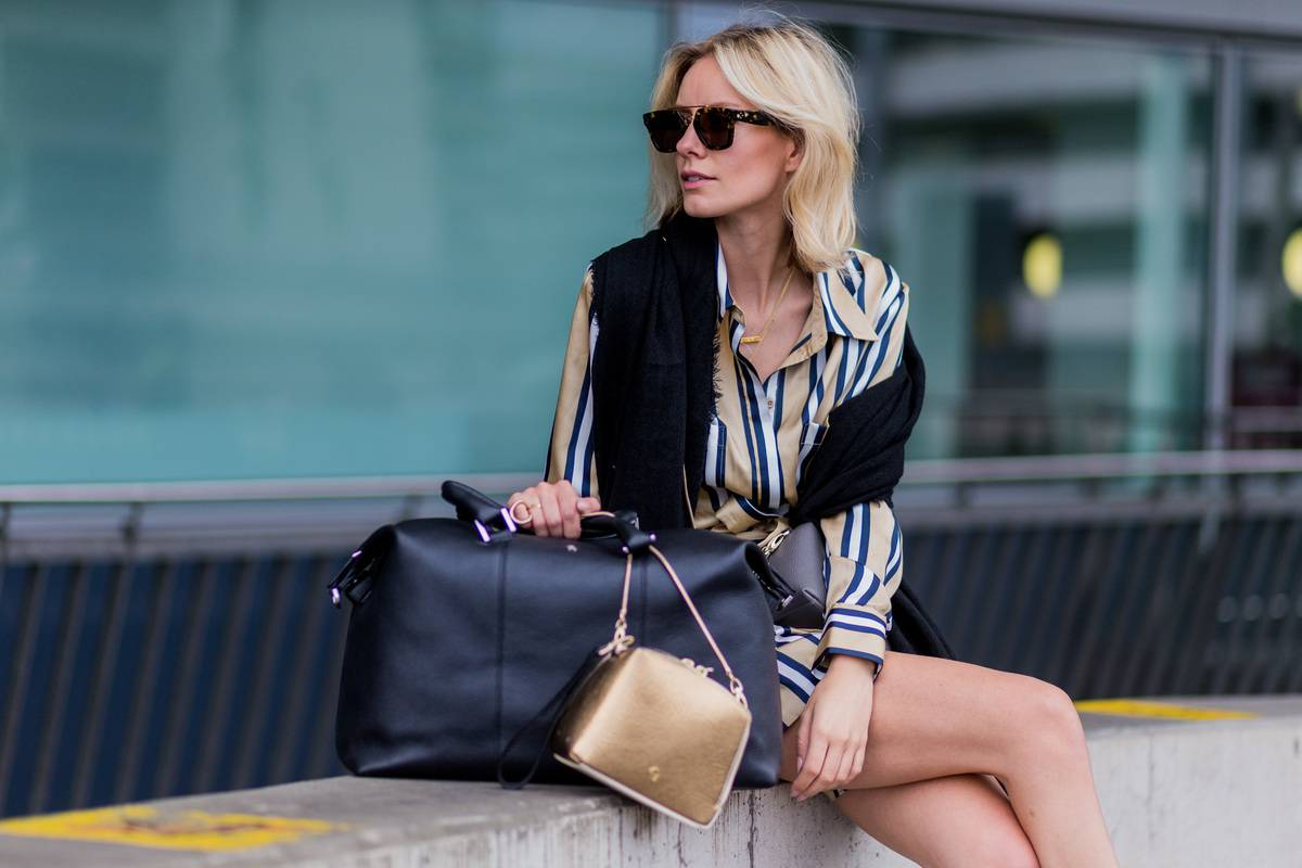 Lisa Hahnbueck at the airport wearing a striped blouse and shorts from Finders Keepers, black Celine sunglasses, a black scarf a black weekender bag from Aigner Munich and golden bag on June 1, 2016 in Duesseldorf, Germany