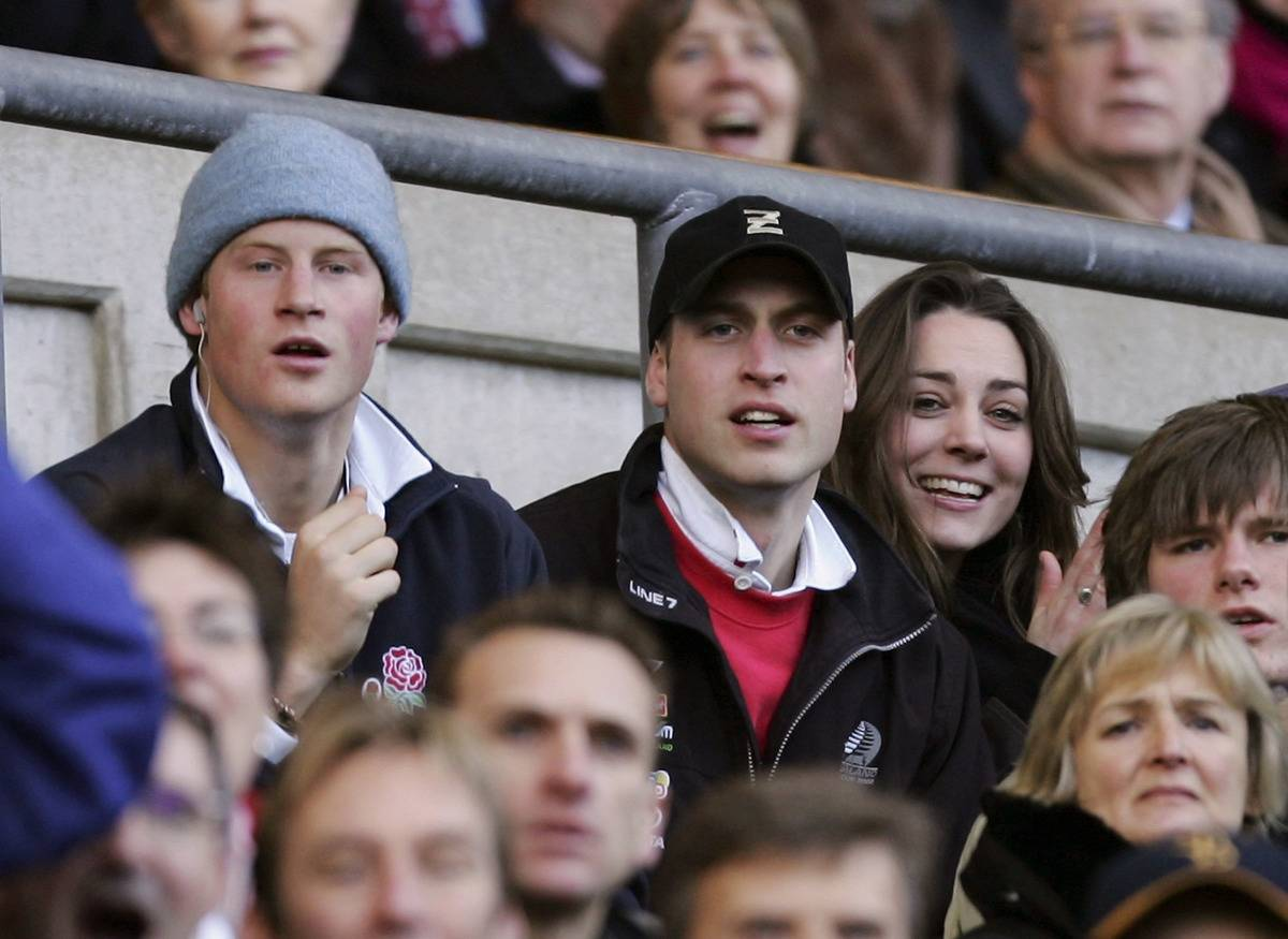 Prince Harry (L) and Prince William (C) and Kate Middleton (R) watch the action during the RBS Six Nations Championship match between England and Italy at Twickenham on February 10, 2007 in London, England