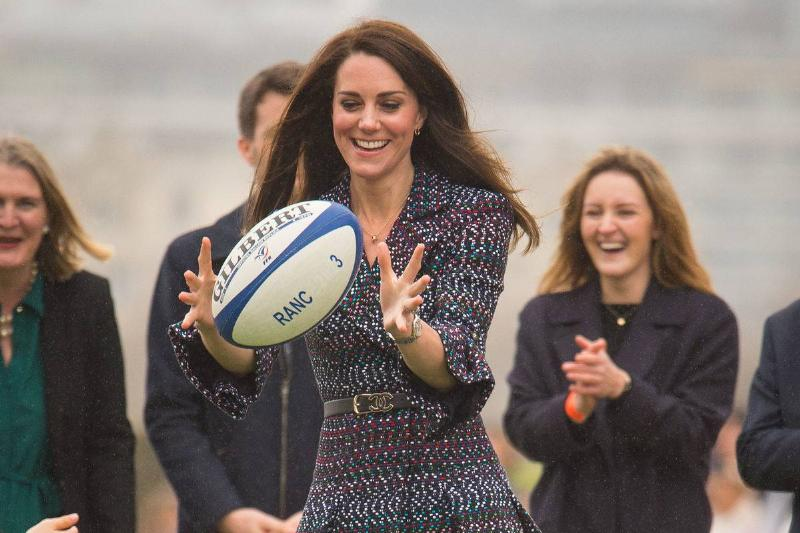 The Duchess of Cambridge at the Trocadero, catching a rugby ball as she attends a