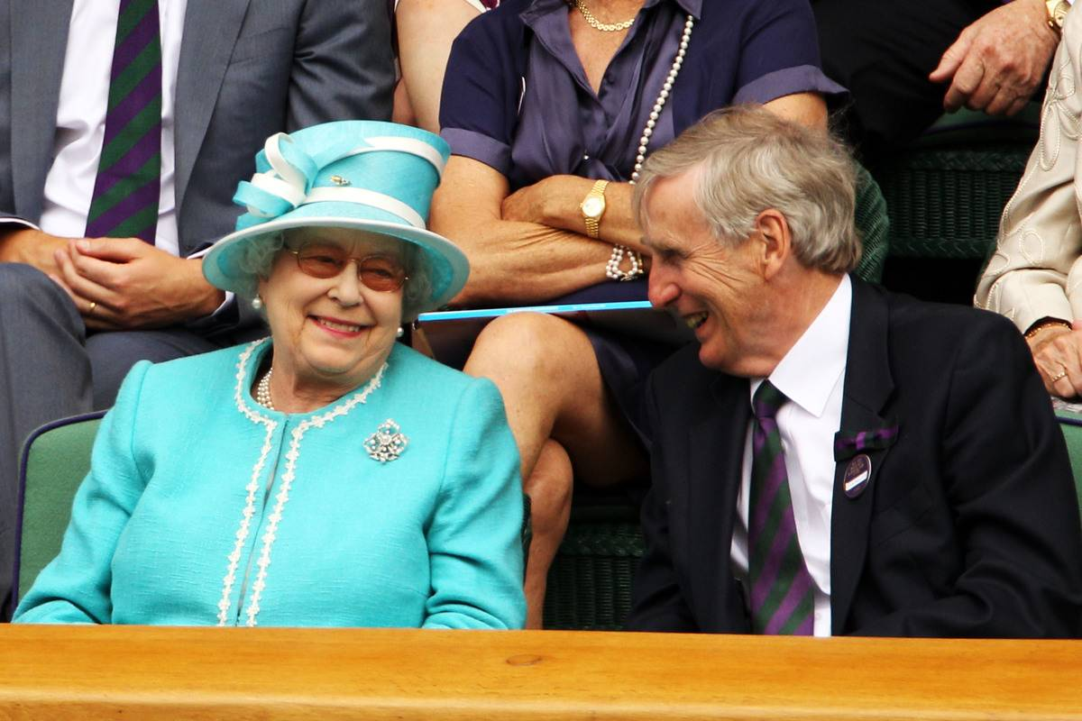 Queen Elizabeth II watches Andy Murray at the Wimbledon Lawn Tennis Championships, escorted by Wimbledon Chairman Tim Phillips CBE on Day 4 at the All England Lawn Tennis and Croquet Club on June 24, 2010 in London, England