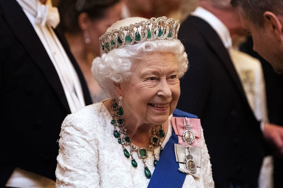 Queen Elizabeth II talks to guests at an evening reception for members of the Diplomatic Corps at Buckingham Palace on December 11, 2019 in London, England